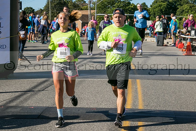 Jeannine Turgeon and her dad Kevin cross the finish line together at the 3rd annual Seacoast Cancer 5K held in Dover Sunday. Photo by Scott Patterson/Fosters.com