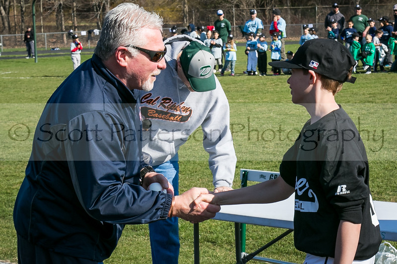 Dave Hoyt of USA Training Center, left, shakes hands with Matt Smith, right, after throwing out the first pitch during Dover baseball opening day ceremonies in Dover Saturday. [Scott Patterson/Fosters.com]