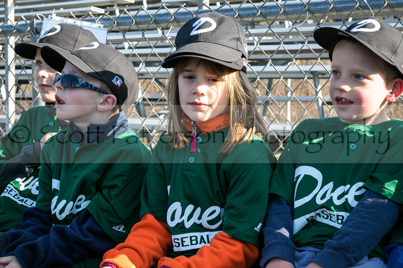 Dover Baseball players Jack Bonello, Jackson Corbin, Abigail Cullinane and Austin Cowper, right to left, participate in opening day ceremonies in Dover Saturday. [Scott Patterson/Fosters.com]