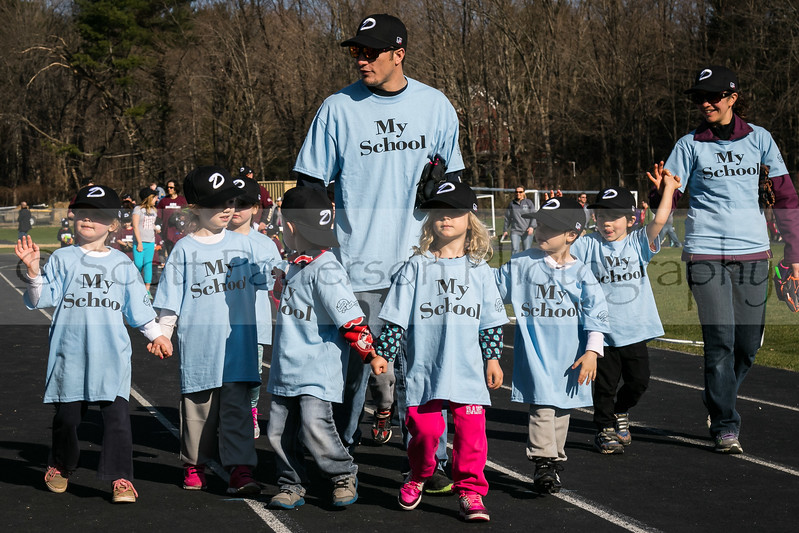Dover Baseball players from the My School team participate in opening day ceremonies in Dover Saturday. [Scott Patterson/Fosters.com]