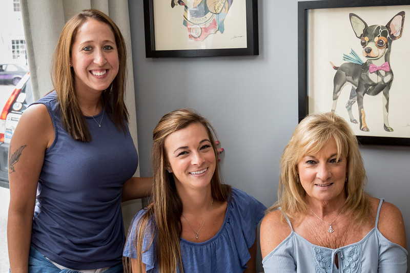 Jessica Lollio, Courtney Durant and Deb Durant, from left, enjoy the grand opening of Downtown Dog Grooming in Dover on Saturday. [Scott Patterson/Fosters.com]