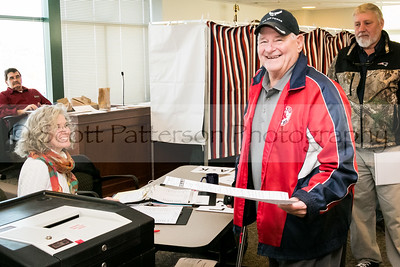 Walter Ross votes at Somersworth City Hall Tuesday. Photo by Scott Patterson/Fosters.com