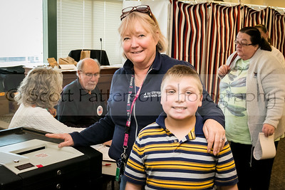 Deborah Ewing-Whaley votes with her son Aiden at Somersworth City Hall Tuesday. Photo by Scott Patterson/Fosters.com