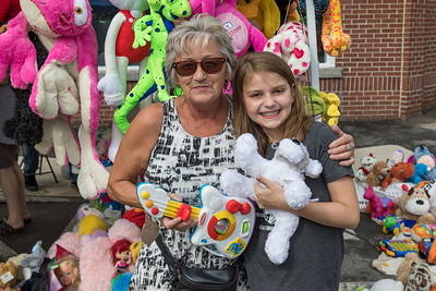 Sue Dupuis and Maddie Painter, from left, enjoy some toys at the Farmington annual Hay Day Celebration in Farmington Saturday. [Scott Patterson/Fosters.com]