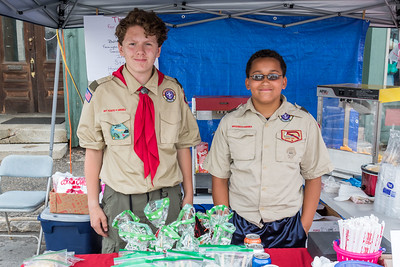 Abraham Aylard, left, and Jadn Henry, right, sell food to support Boy Scout Troop 188 during Farmington's annual Hay Day Celebration in Farmington Saturday. [Scott Patterson/Fosters.com]