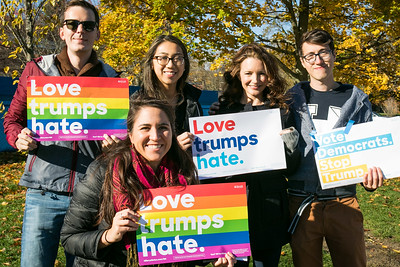 Actress Kristin Davis, second from right,  holds signs with volunteers while campaigning for Hillary Clinton at UNH in Durham Friday. Photo by Scott Patterson/Fosters.com