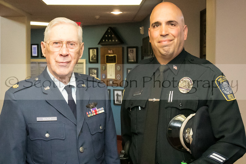 WWII veteran Major Colby Walker, left, stands with Dover Police Officer Paul Levin to celebrate Veteran's Day at Maple Suites Independent Retirement Living in Dover Friday. Photo by Scott Patterson/Fosters.com