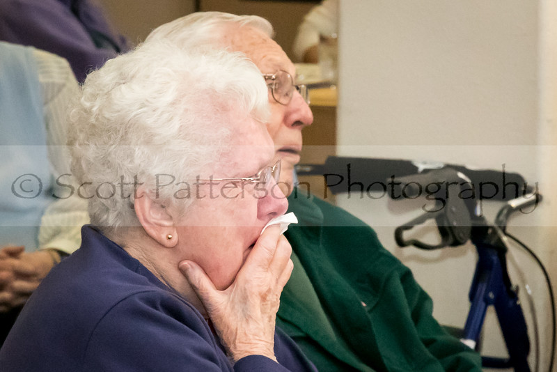 An emotional Jeanne Smart sings along to God Bless America while celebrating Veteran's Day at Maple Suites Independent Retirement Living in Dover Friday. Photo by Scott Patterson/Fosters.com