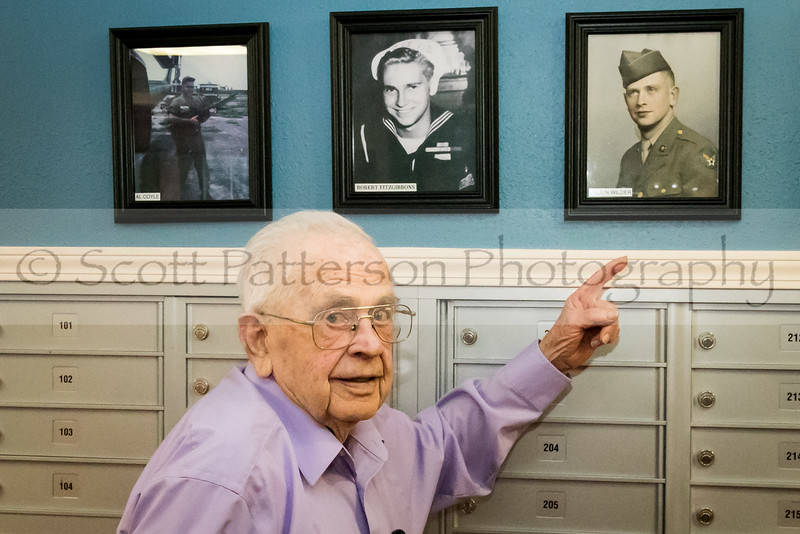 WWII veteran Calvin Wilder points to a photo of himself taken in the early 1940's while celebrating Veteran's Day at Maple Suites Independent Retirement Living in Dover Friday. Photo by Scott Patterson/Fosters.com