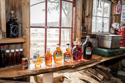 Finished maple syrup on display at Fat Peach Farm in Madbury Sunday. [Scott Patterson/Fosters.com]