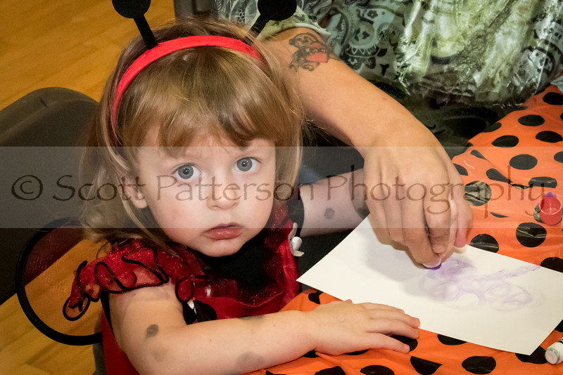 Finley Eaton, age 2, gets help with some artwork during the Rochester Recreation Department's Halloween Party in Rochester Saturday. Photo by Scott Patterson/Fosters.com
