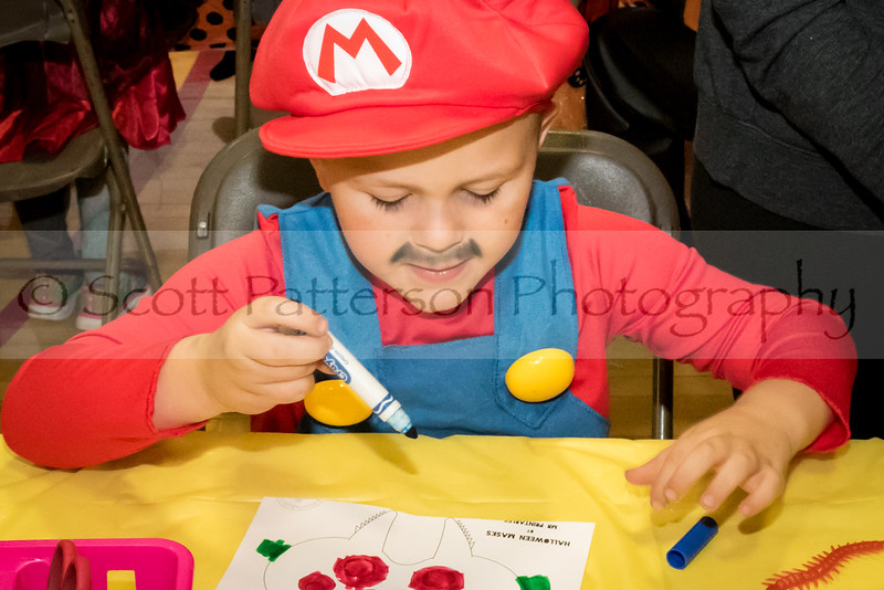 Kane Robertson, age 5, colors during the Rochester Recreation Department's Halloween Party in Rochester Saturday. Photo by Scott Patterson/Fosters.com
