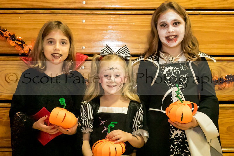 Caiden Brand, age 8, Shaylee Phillips, age 8, and Aubrey Brand, age 9, show off their pumpkin making skills at the Rochester Recreation Department's Halloween Party in Rochester Saturday. Photo by Scott Patterson/Fosters.com