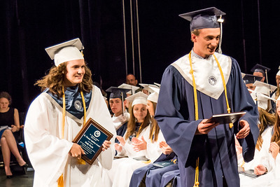 Molly Doyle, left, and Brendan Sullivan, right, are awarded the St. Thomas Aquinas Award during the St. Thomas Aquinas High School graduation ceremony at The Music Hall in Portsmouth Sunday. [Scott Patterson/Fosters.com]