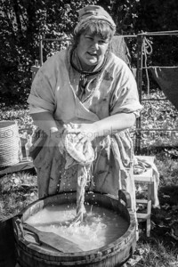 Jennifer Roy washes laundry during the Colonial Militia Muster and Market Fair held at the Colonel Paul Wentworth home in Rollinsford Saturday. Photo by Scott Patterson/Fosters.com