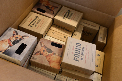 Tania Barricklo-Daily Freeman    Merchandise boxes with Claude's photo featured.