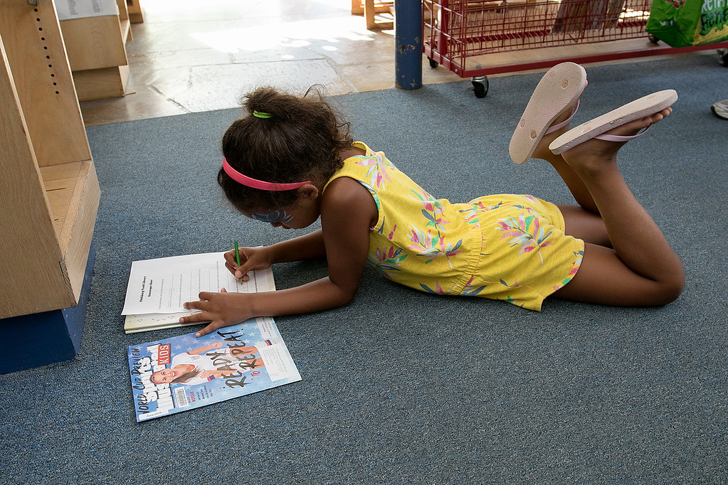 . The Fitchburg Public Library held a summer Reading Kickoff Party on Thursday, June 27, 2019. Sophia Baez, 6, from Fitchburg works on filling out the worksheet for the scavenger hunt they had during the party. SENTINEL & ENTERPRISE/JOHN LOVE