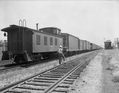 2009.026.25.1555--ritzman 4x5 neg--CB&Q--wooden cabose 13915 on hind end of eastbound freight train scene--Mendota IL--1956 0701