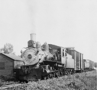 2009.026.21.0766--ritzman 4x5 COPY neg [from LP Gillum]--CB&Q--steam locomotive 4-6-0 K-2 659 with mixed freight train on last trip on old FCNG--DeLong IL--1934 0823