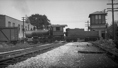 2009.026.21.0783--ritzman 116 neg--CB&Q--steam locomotive 0-6-0 G-3 1544 with freight cars backing over diamond at OX interlocking tower--Sterling IL--1935 0900