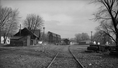 2009.026.26.0017--ritzman 116 neg--CB&Q--scene looking northwest at freighthouse coal chute and depot--Batavia IL--1958 0831