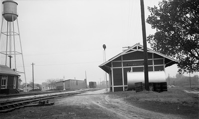 2009.026.15.14246--ritzman 116 negative--CGW--depot--Dyersville IA--1957 0510. Station north of track.