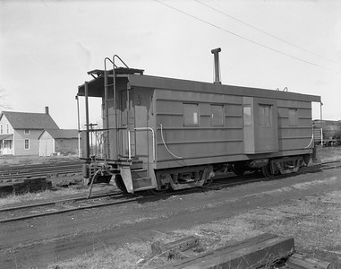 2009.026.12.8549--ritzman 4x5 negative--CMStP&P--caboose 01882--Davis Junction IL--1954 0221