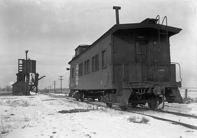 2009.026.12.09722--ritzman 5x7 neg--CMStP&P--wooden caboose 0623--DeKalb IL--1948 0210. Looking north.