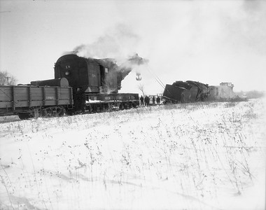 2009.026.17.8585--ritzman 4x5 negative--CMStP&P--wrecker X-4 action with steam locomotive 327 derailed--Bradt IL--1950 1210