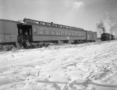 2009.026.17.8595--ritzman 4x5 negative--CMStP&P--wrecker coach X-654--Bradt IL--1950 1210. Steam locomotive L3 333 on frozen branchline.