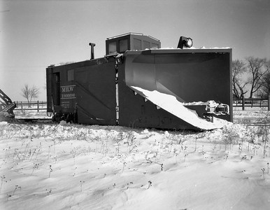 2009.026.17.8601--ritzman 4x5 negative--CMStP&P--Russell snow plow X-900090 derailed with steam locomotive 327--Bradt IL--1950 1209