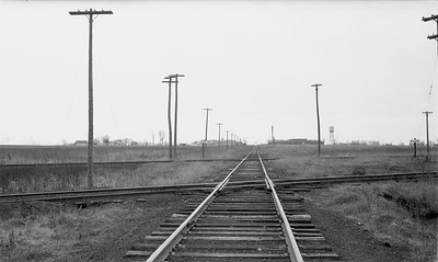2009.026.19.8639--ritzman 116 negative--CMStP&P--view of C&NW and CGW crossings--DeKalb Jct IL--1947 0413. Looking south.