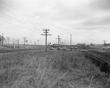 2009.026.19.8616--ritzman 4x5 negative--CMStP&P--view looking east at site of depot with approaching freight train--Almora IL--1964 0202