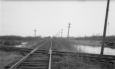 2009.026.19.8641--ritzman 116 negative--CMStP&P--view of C&NW and CGW crossings--DeKalb IL--1947 0413. Looking north.