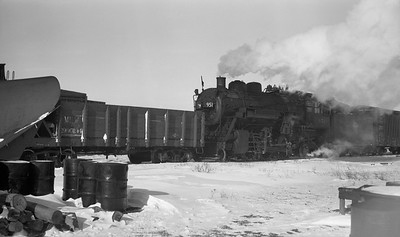 2009.026.01.09470--ritzman PC negative--CMStP&P--steam locomotive 2-6-2 K1as 951 with snowplow extra action--DeKalb IL--1947 0104. 12:00 noon. 12 inches snow 1/3/1947 and engine 424 and plow alone went thru as extra 3:00pm on 1/3/1947. Drifted at night hence 951 with plow south 1/4/1947. FRR
