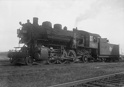 """2009.026.01.09432--ritzman 5x7 neg--CMStP&P--steam locomotive 2-6-2 K1as 901--DeKalb IL--1947 1028. """"Sample of back-in technique which appeared after abandonment (Aurora line) in August 26, 1947. Originally August-September head in, back out. Then in October, back-in, head out mainly because trips down the line for scrap need engine headed north. 901 and 920 acquired back-up lights, numbers, etc."""" FRR"""