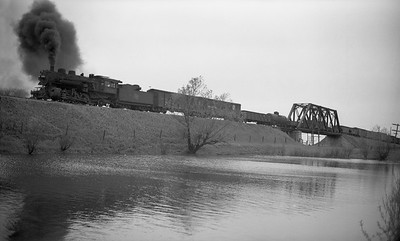 2009.026.01.09465--ritzman PC negative--CMStP&P--steam locomotive 2-6-2 K1as 944 on southbound freight train 87 action--east of DeKalb IL--1947 0520. Bridge 118 over C&NW in distance.