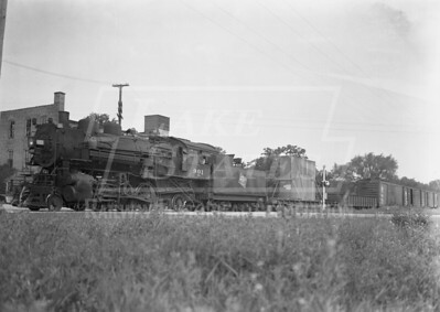 2009.026.01.09425--ritzman 5x7 neg--CMStP&P--steam locomotive 2-6-2 K1as 901 with southbound freight train--DeKalb IL--1945 0724. Near Sycamore Road crossing, Route 23.