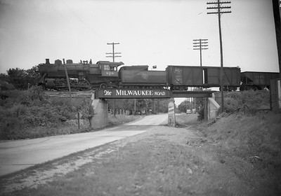 2009.026.01.09444--ritzman 5x7 neg--CMStP&P--steam locomotive 2-6-2 K1as 929 on southbound freight train--east of DeKalb IL--1943 0731. 11:35am on overpass over Lincoln Highway (US 30), looking west.