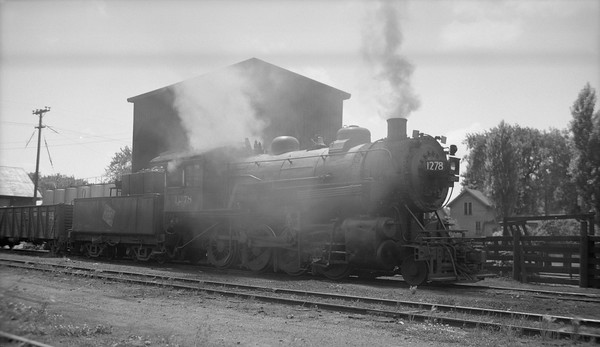 2009.026.01.09590--ritzman PC negative--CMStP&P--steam locomotive 2-8-0 C2s 1278 being fired up--Waupun WI--1951 0617. Looking west against the sun.