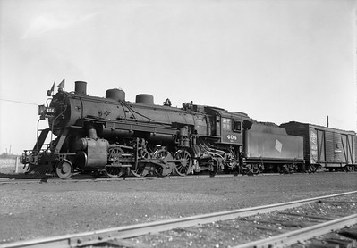 2009.026.01.09362--ritzman 5x7 neg--CMStP&P--steam locomotive 2-8-2 L2b 404--DeKalb IL--1942 0424