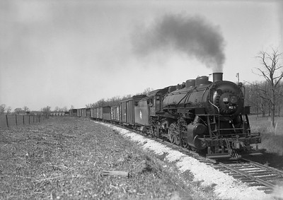 2009.026.01.09367--ritzman 5x7 neg--CMStP&P--steam locomotive 2-8-2 L2b 424 with southbound freight train--near DeKalb IL--1942 0423. 24 cars.