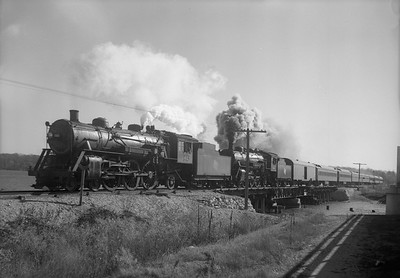 2009.026.01.09288--ritzman 5x7 neg--CMStP&P--steam locomotive 4-6-2 F3s 161 and 164 with football passenger train for Madison--Fox Lake IL--1940 1102. Westbound 1st section of train 17 U. of Ill. football (IC cars) fans to U. of Wis. Madison.