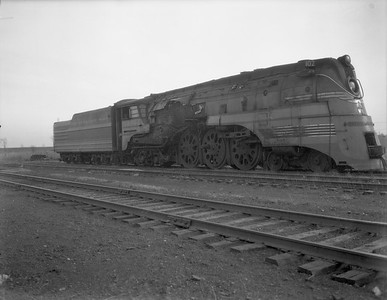 """2009.026.01.8008--ritzman 4x5 negative--CMStP&P--steam locomotive 4-6-4 F-7 102 (dead) after throwing rod--Bensenville IL--1950 1117. """"102 was in Morton Grove Hiawatha mess, threw rod on right side about two months ago."""" FRR"""