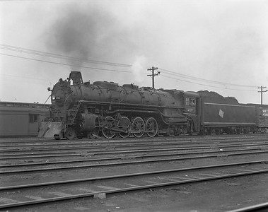 2009.026.01.8066--ritzman 4x5 negative--CMStP&P--steam locomotive 4-8-4 S-2 209 in yard on train--Bensenville IL--1940 0614