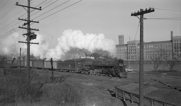 2009.026.01.09350--ritzman PC neg--CMStP&P--steam locomotive 4-8-4 S2 236 on eastbound freight--Elgin IL--1948 1216. Elgin watch factory in background.