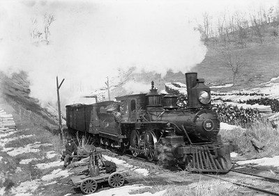 2009.026.01.14684--ritzman 5x7 COPY neg [WA Anderson]--Wisconsin & Western--steam locomotive 4-4-0 5 at tunnel--9 miles north of Wauzeka WI--before 1903. W&W went to CM&StP in 1903.