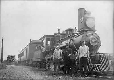 2009.026.01.09613--ritzman 5x7 neg [AM Rogers]--CMStP&P--steam locomotive 4-4-0 H3 1426 with AM Rogers engineer--Richland Center WI--1902 0000. Rogers is standing in front of locomotive. He retired on 3/9/1947.