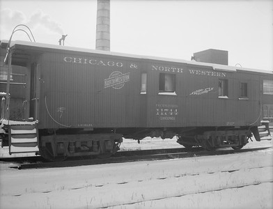 2009.026.12.11313--ritzman 4x5 neg--C&NW--wooden caboose 11744 (retired)--DeKalb IL--1958 1208. Condemned, sold to Max Schlossberg.