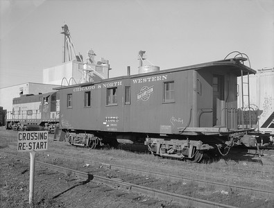 2009.026.12.11310--ritzman 4x5 neg--C&NW--wooden caboose 11578--DeKalb IL--1958 1122. Condemned, sold to the Purdy Co.